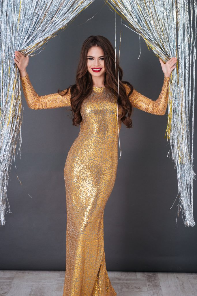 rsz_Woman-in-gold-dress.jpg April 10, 2019