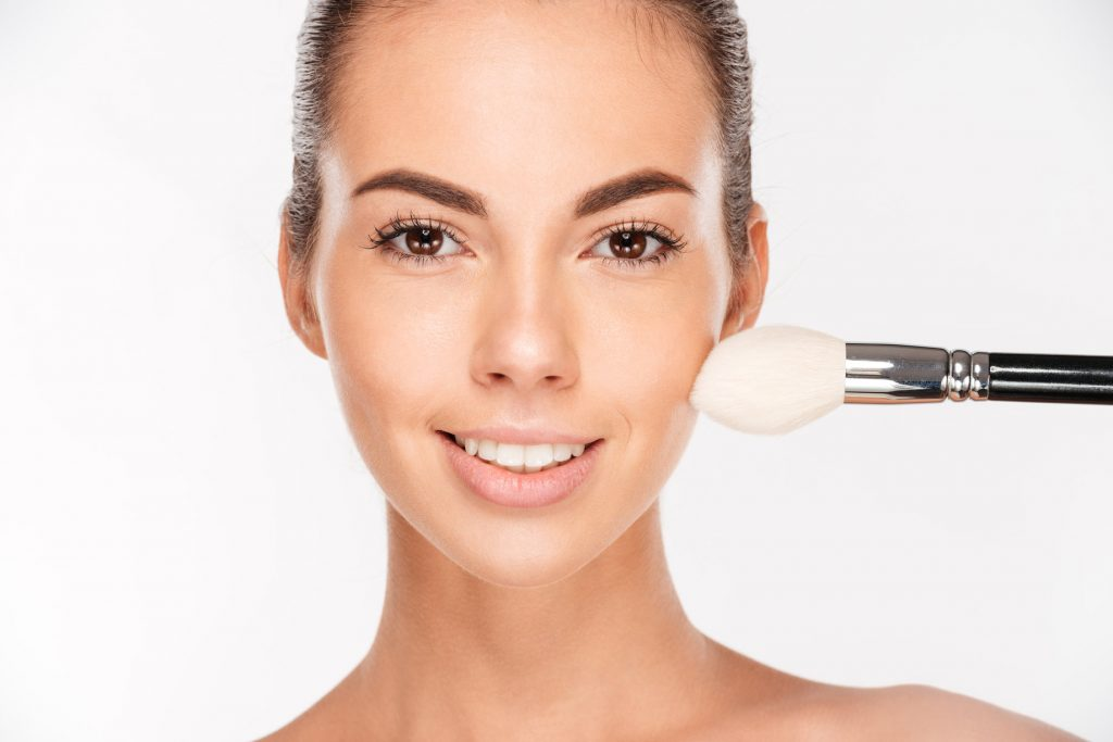 sz_girl_with_makeup_brush_-_timeless_skin_care.jpg