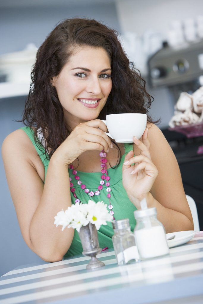 rsz_a-young-woman-drinking-tea-in-a-cafe_by7ls7rri.jpg